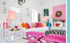 Maria Barros' home/white living room with pink, orange, zebra accents