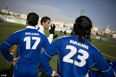 In this Friday Feb. 7, 2014 photo, Wadi al-Nees players warm up before a league game at a ...