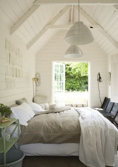 Love the natural light and greige bedding .... #bed #volume #white #wood #house #home #loft #french #windows #bedding #greige #light #painted #linen #house #home  Upperbedroom front to back, white art on white wood walls - white lamps