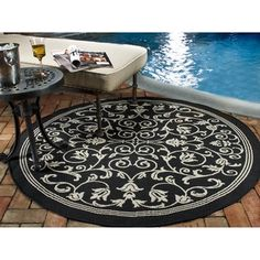 Shop for Safavieh Indoor/ Outdoor Resorts Black/ Sand Rug (6'7 Round). Get free shipping at Overstock.com - Your Online Home Decor Outlet Store! Get 5% in rewards with Club O!