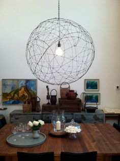 I am going to make this! Crazy, cool and not expensive! Wire hanging lamp DIY