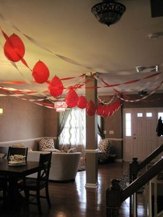 String balloons using a needle and thread for an easy and fun party decoration