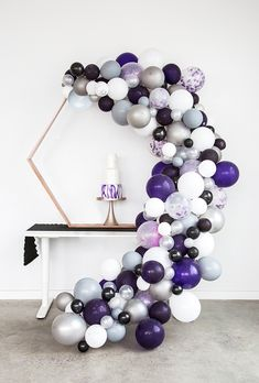 Purple geometric wedding cake balloon arch