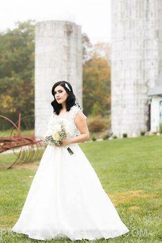 Vintage bride. Barn wedding. Our vintage glam fall wedding. #broach #newjersey #wedding #vintagewedding #fallwedding #glamwedding #glam #fall #wedding #peronafarms #nj #bride #groom #weddingplanning #vintage #bride #groom #justmarried #inspiration #weddingideas #masonjar #babysbreath #vintagebride #tealandgray #teal #gray #shrug #alenconlace #ostrichfeathers #brideshrug