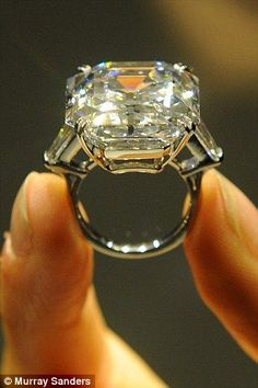 The Elizabeth Taylor 33.19-carat white diamond ring. COULD YOU IMAGINE?? The weight would be crazy!