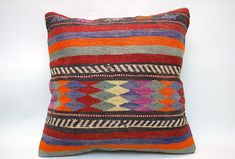 Kilim pillows are the most beautiful trend of using recycled hand-woven fabrics that not only give an extra to your space but also increases the overall look of the room. Besides providing rigidity, kilim pillows also give luxurious texture to any other room. #KilimPillow #KilimCushion #KilimPillowCover #KilimCushionCover #KilimCase #KilimCover #DecorativePillow #VintagePillow #TurkishPillow #ThrowPillow #HandmadePillow #BohoPillow #BohemianPillow #SquarePillow #20x20Pillow #Pillow #Cushion Kilim Cushions, Boho Pillows, Throw Pillows, Decorative Pillows, Handmade Pillows, Cushion Covers, Pillow Covers, Vintage Pillows, Geometric Pillow