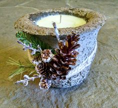 Hand poured soy candle in handmade stone planter.