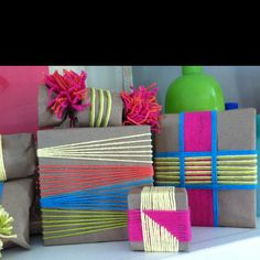 Wrapping my gifts with colorful yarn. Easy and fun! Come in for a demo Saturday, December 22nd!