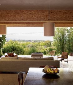 Architects Frank Escher and Ravi GuneWardena's design may be strict in its layout and proportion, but it lends itself to casual living.  ...
