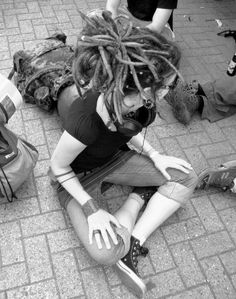 Girl sitting with long dreadlocks pulled up   Black and white photo