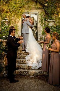 ceremony on ivy-draped steps.