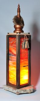 Sunset stained glass with Madagascar ebony, with tassel. Curly  maple top brass corners and copper painted top with beaver fur and European coin. Granite base.