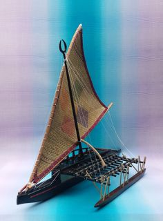 A 20 inch long scale model of a type Camakau from Fiji. The life size model is on permanent display at the Polynesian Cultural Center, Laie, Hawaii. Plywood Boat, Wood Boats, Canoe For Sale, Model Sailing Ships, Polynesian Cultural Center, Scale Model Ships, Outrigger Canoe, Boat Fashion, Boat Design