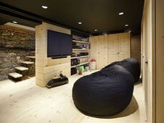 The cellar has been converted into a media room with paneled wood interior and a floating staircase.