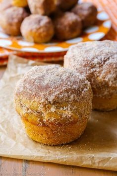 Pumpkin muffins coated with cinnamon sugar. They taste like your favorite pumpkin muffins from the bakery! sallysbakingaddiction.com