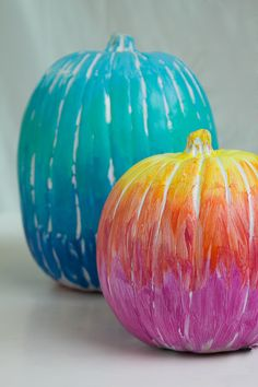 Cute and easy ideas for decorating pumpkins: ombre, puffy paint, and glitter.
