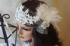 Beautiful Venice lace embroidery with Russian veil and soft  feathers and a beautiful pearls and rhinestones brooch , head wrap for brides in white also available in ivory ! I can customize it to a headband if you want with ribbon or elastin in the back !