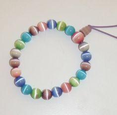 562 Multi Pastel Colored Cats Eye Bead Stretch Bracelet Purple Cord | eBay