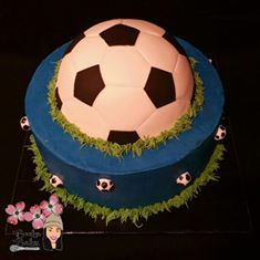 This 12 inch amazing soccer themed cake comes with matching soccer pops and Pooka poppers. Buttercream base and fondant covered French Vanilla soccer ball www.bookabakes.com #soccer #futbol #sports #grass #dcunited #mls #Barcelona #chocolate #mlssoccer #coloradorapids #easternconference #westernconference #CustomCakes #noveltycake 
