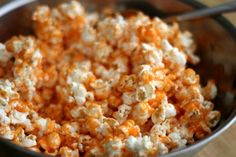 Jello Popcorn: Preheat oven to 300.  Line 2 baking pans with foil.  In one small saucepan over medium-low heat melt 1/4 cup butter and 3 Tbsp of corn syrup together until butter is melted. Add 1/2 cup sugar and 1 package of jello. Stir until sugar is dissolved and bring to a boil. Simmer on low for 5 minutes. Immediately remove from heat and pour over one of the portioned bowls of popcorn. Stir until the popcorn is evenly coated. Spread onto a lined baking pan and bake for 10 minutes.