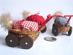 Walnut shell craft- Home decor - walnut shells turned into tiny prams with little occupants resting inside.