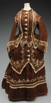 """brown victorian dress front - Stunning 1850-1860s dress, 3 pieces with soutache braid and eyelet trim, back bustle. Some splitting and deterioration. Lovely for a china or papier-mâché doll. 17 ½"""" from front neck to hem."""