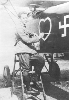 WWI; Werner Voss concentrates on painting the white border around the red heart that has just been added to the fuselage on his Jasta 2 Albatros D III.