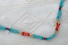 Turquoise and Red Seed Bead Layering by ShopElectricBuffalo