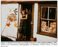 Maud Lewis in front of her painted home in 1961