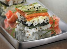 Smoked salmon sushi squares are an interesting and easy way to make sushi. You could substitute any sushi filling that you desire.