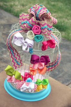 Corral your kids' hair accessories in a pretty bird cage.