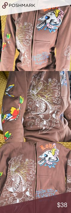 """Ed Hardy Brown Skull Jacket Girls Youth Size Large This is a very neat Ed Hardy jacket for girls! Features beautiful butterflies on the sleeves, a cool """"love skull"""" design, with a swimming Koi Fish picture on the hood and front. The style of this hooded jacket is rare, and beyond awesome!  If you appreciate old school quality - you're in the right place. We don't just sell products, we put time & work into them. We ship fast, usually within 1 business day! Enjoy! Ed Hardy Jackets & Coats"""