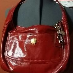 AUTHENTIC! Coach purse! Authentic Coach purse ...looking to sell or trade ! Excellent Condition. ..hardly used.. has charms ..As you see in the pics ...;) Coach Bags Totes