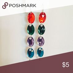 Color Blocked Dangling Earrings Color blocked long dangling earrings. Colors on earrings include red, dark green, lavender and teal. Two available in stock. Other colors also available. Jewelry Earrings