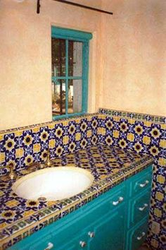 This picture taken in the 80's shows the original tiles and cabinets in the bathroom off Marilyn's bedroom.