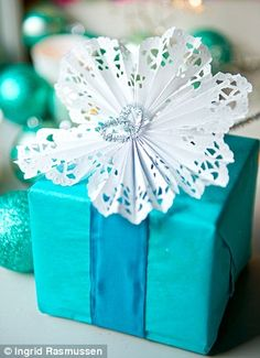 present wrapping with doileys for decoration