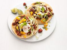 Get this all-star, easy-to-follow Beef Tostadas with Mango Salsa recipe from Food Network Kitchen