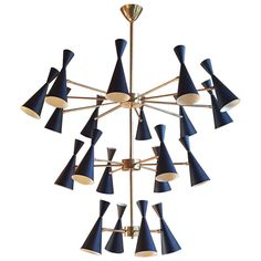 Enormous Italian Modern Brass Chandelier with Adjustable Sconces | From a unique collection of antique and modern chandeliers and pendants at https://www.1stdibs.com/furniture/lighting/chandeliers-pendant-lights/