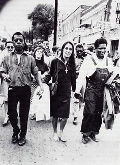 James Baldwin, Joan Baez, James Forman marching in Montgomery, Alabama 1965.