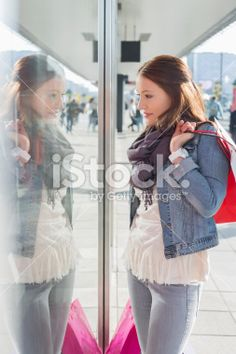 Young woman in casuals window shopping Royalty Free Stock Photo