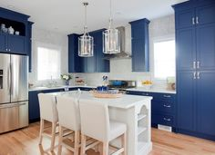 You know what? I think the blue and white cabinetry/island combo is just too much and off-balance either way!