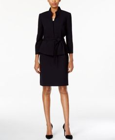 A perfect workday look, this petite skirt suit by Tahari Asl features a self-tie at the waist and a sleek silhouette. | Polyester/rayon/spandex; lining: polyester | Dry clean | Imported | Jacket: stan