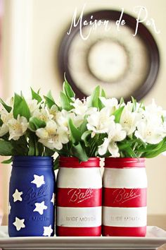 """We particularly love this patriotic combination, where one mason jar is painted as """"stars"""" and the remaining two jars compose the """"stripes."""""""
