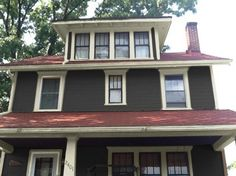 What color do I paint my 80+ year old red roof 2 story house?