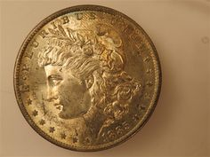US 1885 O Morgan Silver Dollar Coin  Featured in the US Coins Auction on July 25, 2013 HamptonAuction.com