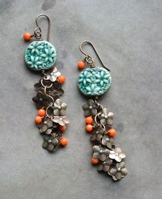 Love these earrings with the pop of orange! \\ via Lorelei's Blog: Newbies