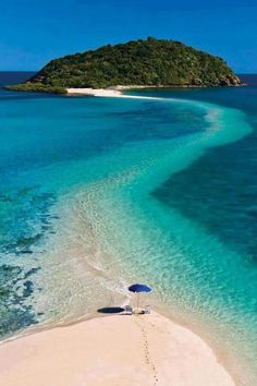 Walk from the main beach to an island, all over water. Sand bar path, Fiji
