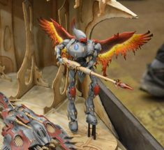 Warhammer 40k Eldar Wraithknight. Not the best photo, but awesome idea for a conversion - using Phoenix wings from a Fantasy kit!