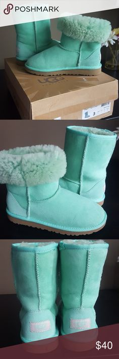 Classic Short UGG  Boots Can also fold boots. Paint on soles these are the splatter style. They look great. In box. Box has a lot of wear. Have been sitting in closet for ever.  These are Kids size 3, which equals to a womens 5 or 5 1/2. See pics 5 and 6 for splatter soles.. These are a true green. Last pic shows true color. UGG Shoes Boots