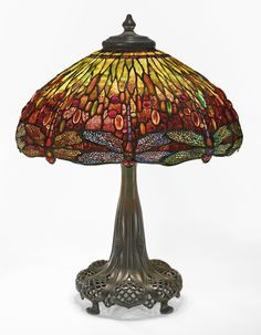 """Tiffany Studios AN IMPORTANT """"DRAGONFLY"""" TABLE LAMP FROM THE COLLECTION OF ANDREW CARNEGIE shade impressed TIFFANY STUDIOS NEW YORK/1507-27 telescopic base impressed TIFFANY STUDIOS/397 leaded glass and patinated bronze"""